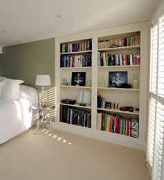 Bespoke fitted alcove unit in bedroom